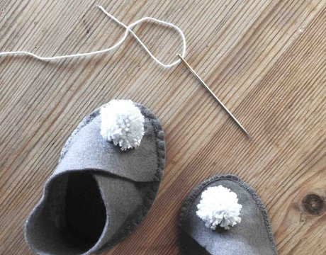 baby slippers and a needle
